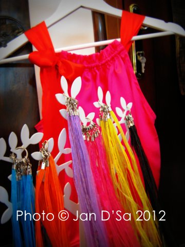 Melanie Gessing's lovely silk tops with some colourful necklace ribbons in the forefront