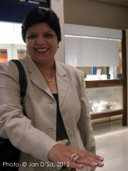 Ms. Oofrish, Marketing Manager of Al Liali Jewelry, shows off a handcrafted Al Liali ring.