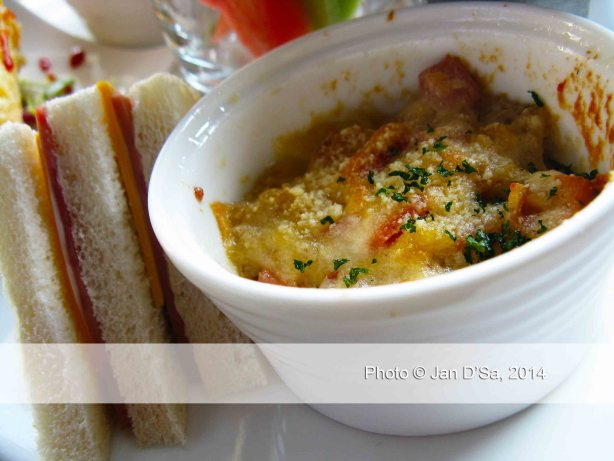A mini-pot of corn, parmesan cheese, halal meat makes a light, casserole like dish