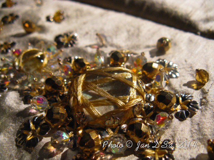 Each design is well-thought before it is executed. This gold and crystal mound of embroidery shows the details.