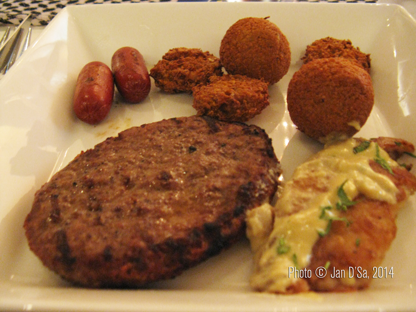 Camel meat burger and camel meat sausages along with freshly prepared falafel