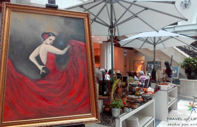 The Flamenco dancer proudly showed off the swish and swirls near the luncheon area of Movenpick Hotel. Painting by Ruxandra Mocean.
