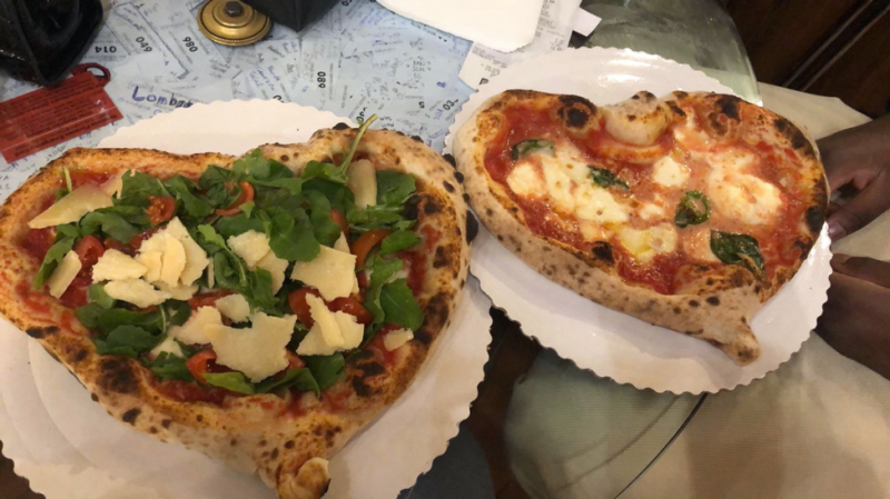 A pizza sitting on top of a plate of food  Description automatically generated