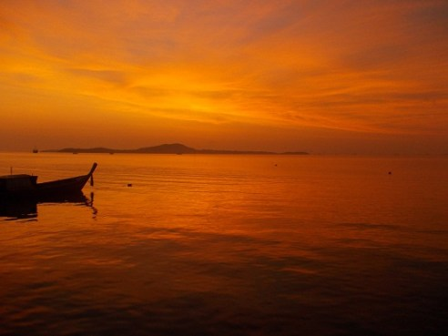 A breathtaking sunrise from the back porchdock in Koh Lanta, Thailand.