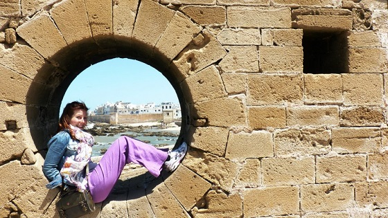 Smiling in Morocco at Essaouira harbour with Bryony Holland