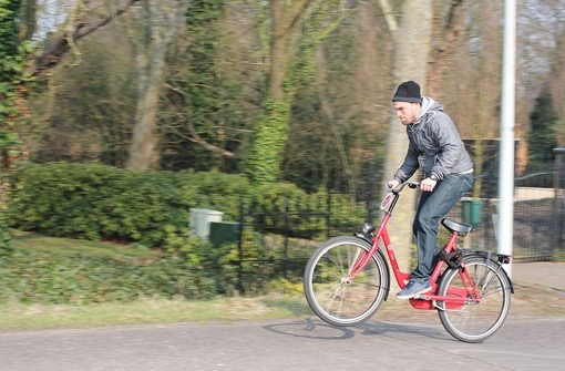 Wes riding a bike in Amsterdam