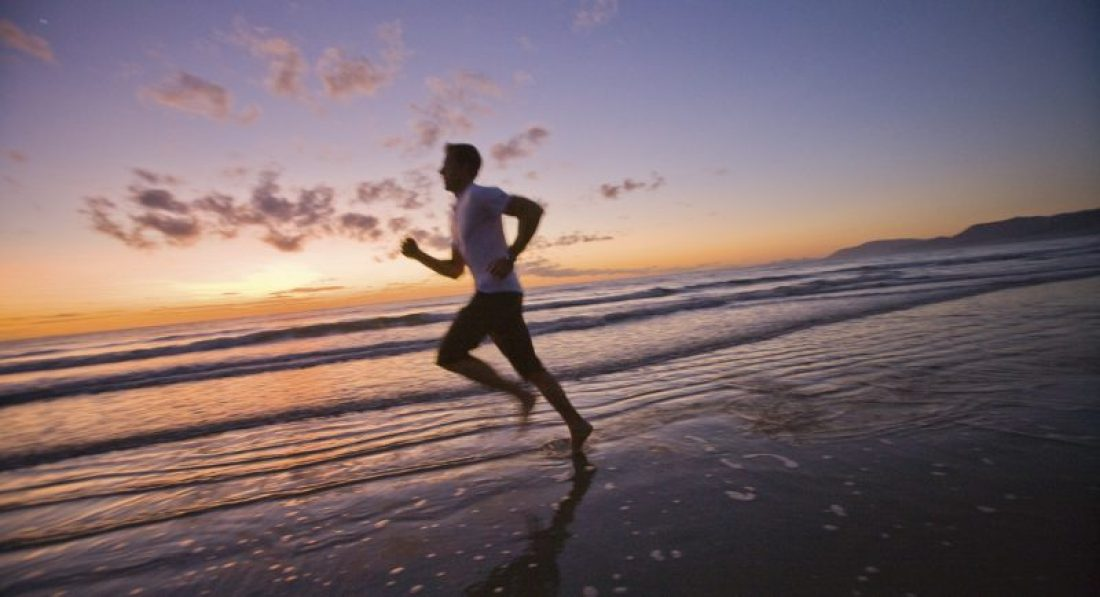 Jogging on Four Mile Beach Port Douglas Queensland Australia