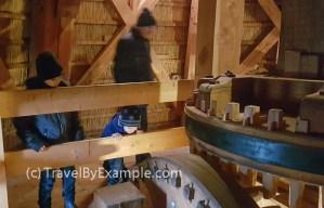 Mechanisms inside Boys learning about windmills inside Molen de Ster, Utrecht