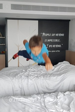 Entertainment in managed isolation: Andrey is flying from bed to bed like a superman