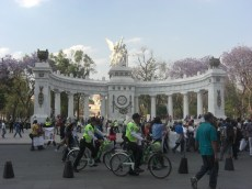 Protesters stream passed the Hemiciclo a Juarez monument