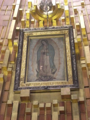 The image of the Virgin seen from a moving walkway in the new Basilica