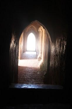 Dark passageway at the massive Dhammayangyi Pahto