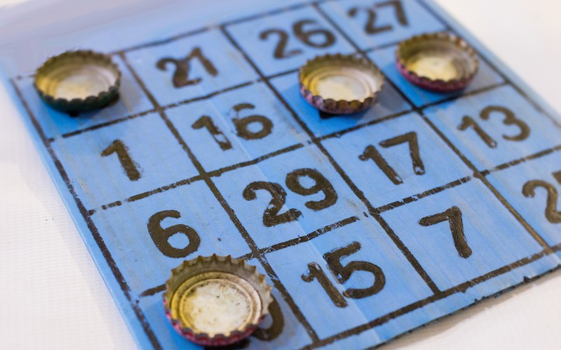 Bingo card played with bottle caps.