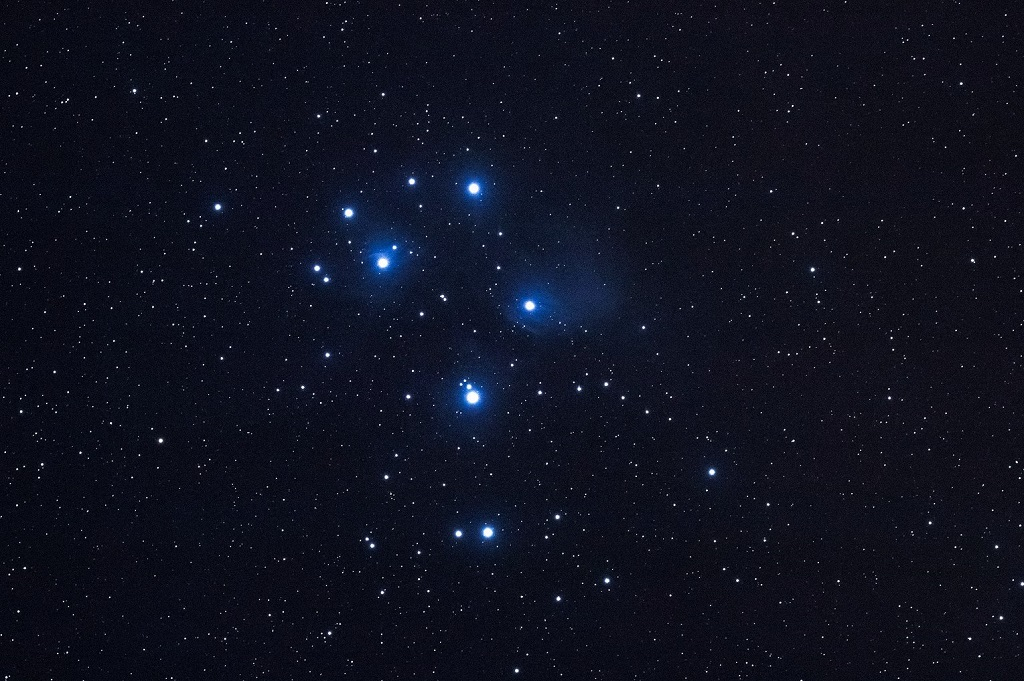 The Pleiades Seven Sisters star cluster in the constellation of Taurus the bull