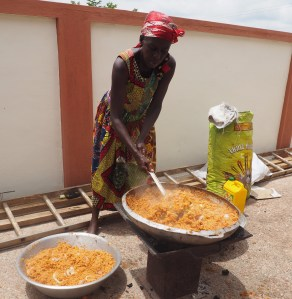 Preparing Jollof for the party guests