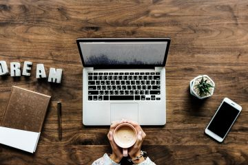 9 Legit Online Jobs with No Experience - Laptop, coffee, phone and the word dream on a table