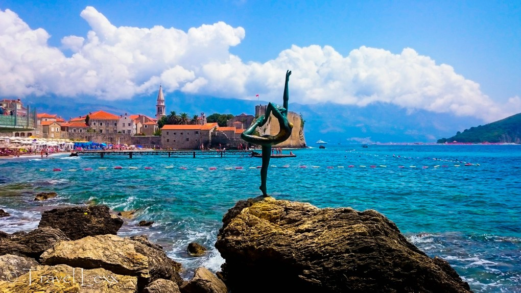 Ballet Dancer statue and Budva Old Town in the background