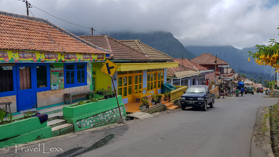Colourful buildings along the road in Cemoro Lawang