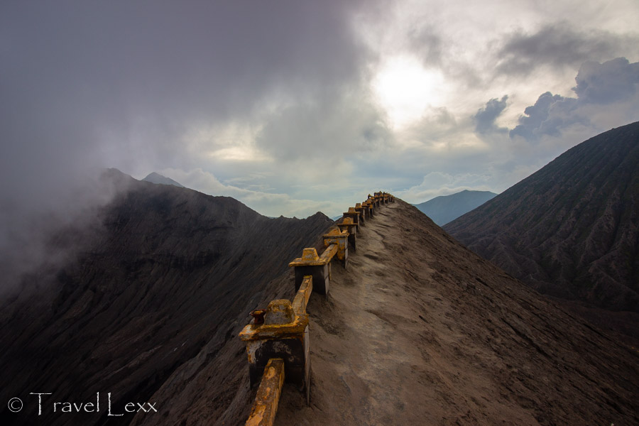 A low railing at the rim of Mount Bromo