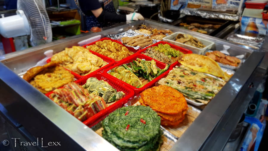 A selection of colourful savoury pancakes at a market stall
