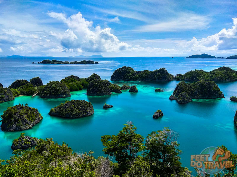 Raja Ampat Islands dotted around a blue water lagoon