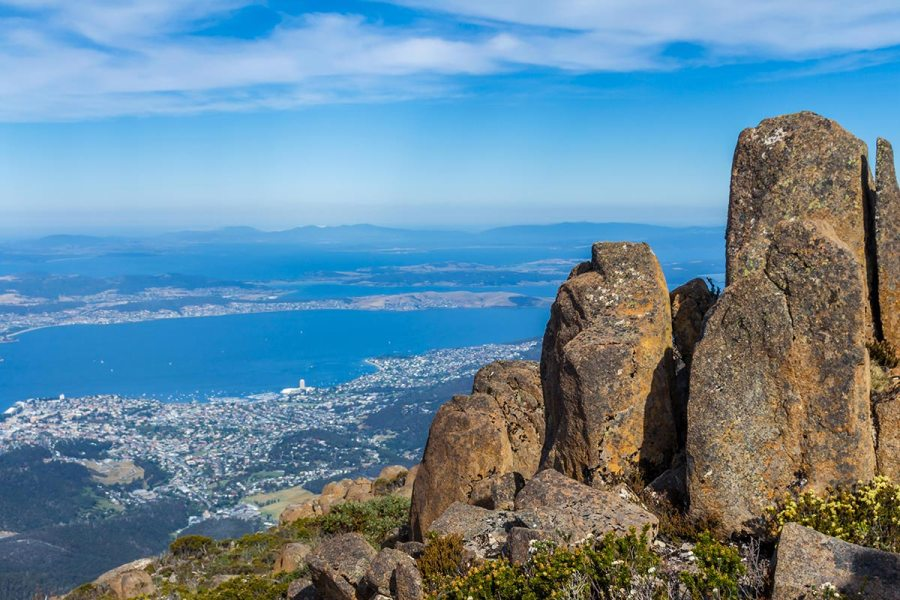 Big vertical rocks at the summit of Mount Wellington overlooking the city of Hobart, Tasmania - one of Australia's best urban hikes