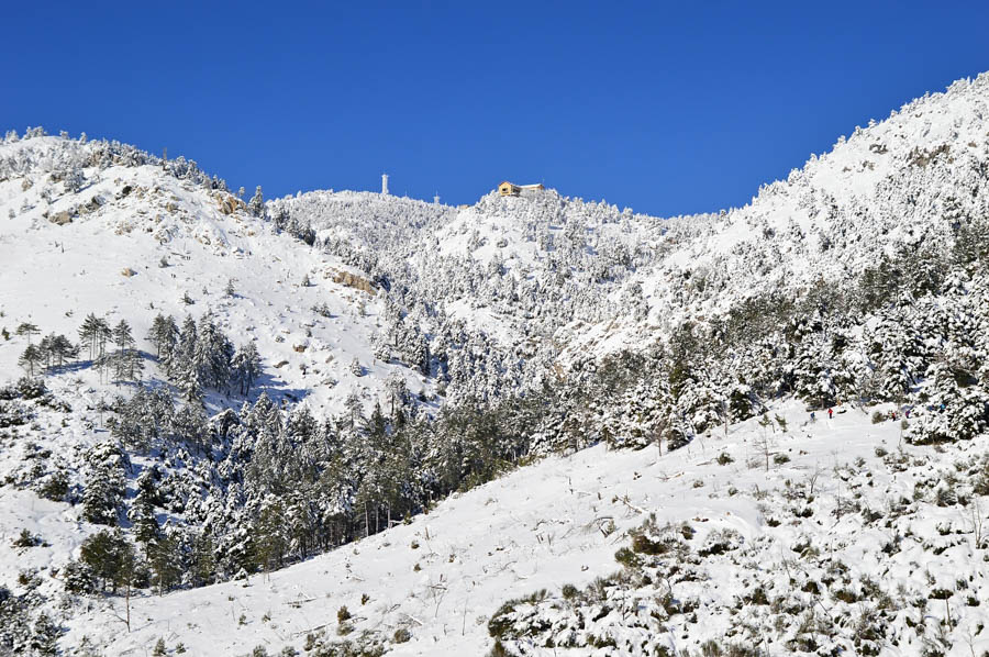 Snow covered slopes and ridges of Mount Parnitha, a day hike destination near city of Athens