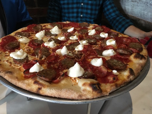 New Yorker: Sliced house link sausage, pepperoni, ricotta on mozzarella and tomato sauce.