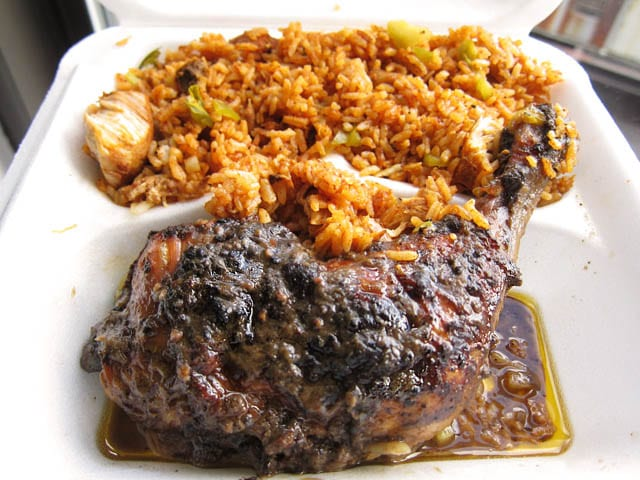 Typical Jamaican jerk chicken with rice and peas