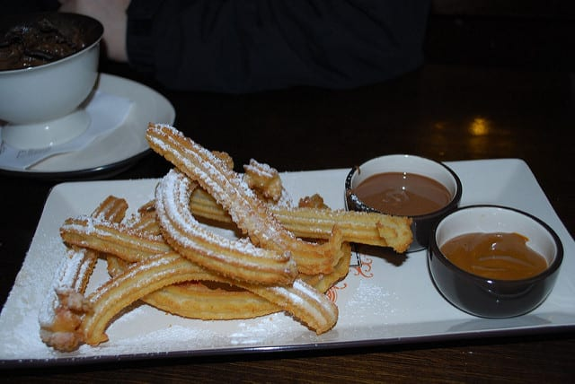 Churros served with dulce de leche are like doughnouts