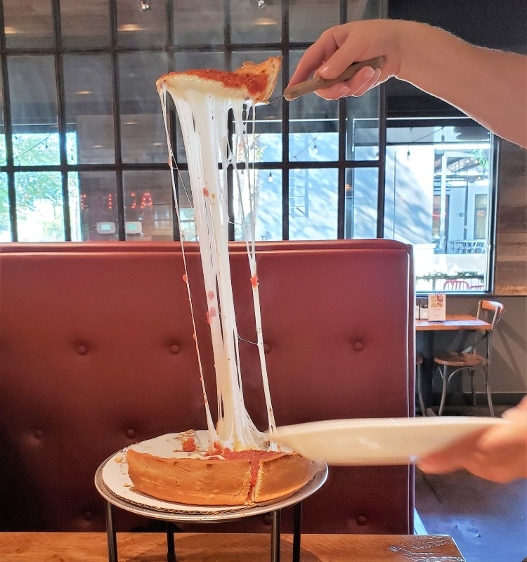 Giordanos Arizona - cheese pull -travel foodie mom