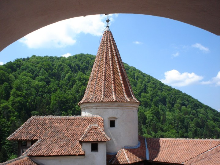 A round tower and tiled roofs in Bran Castle, Transylvania.