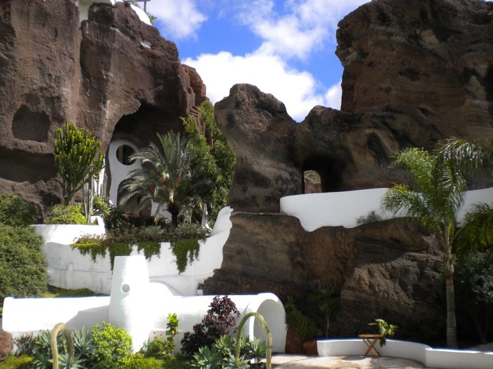 Lagomar Lanzarote - the white tunnel is the entrance to the different sections of the house in the volcanic quarry.