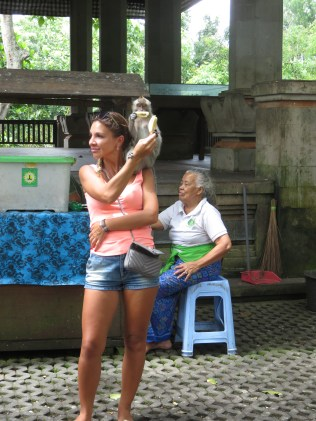 This Lady's got it figured out...or has the monkey?