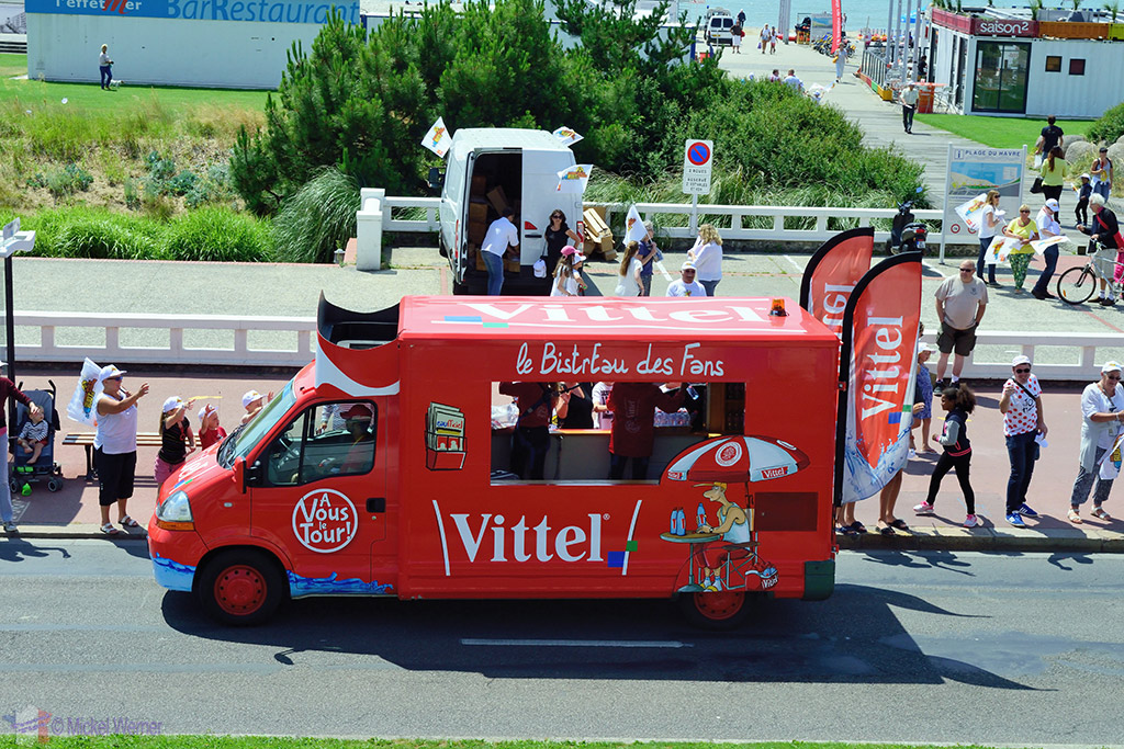 Commercial vans selling water at the Tour de France