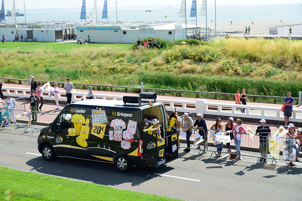 Harnessed staff in the souvenir sales vans at the Tour de France