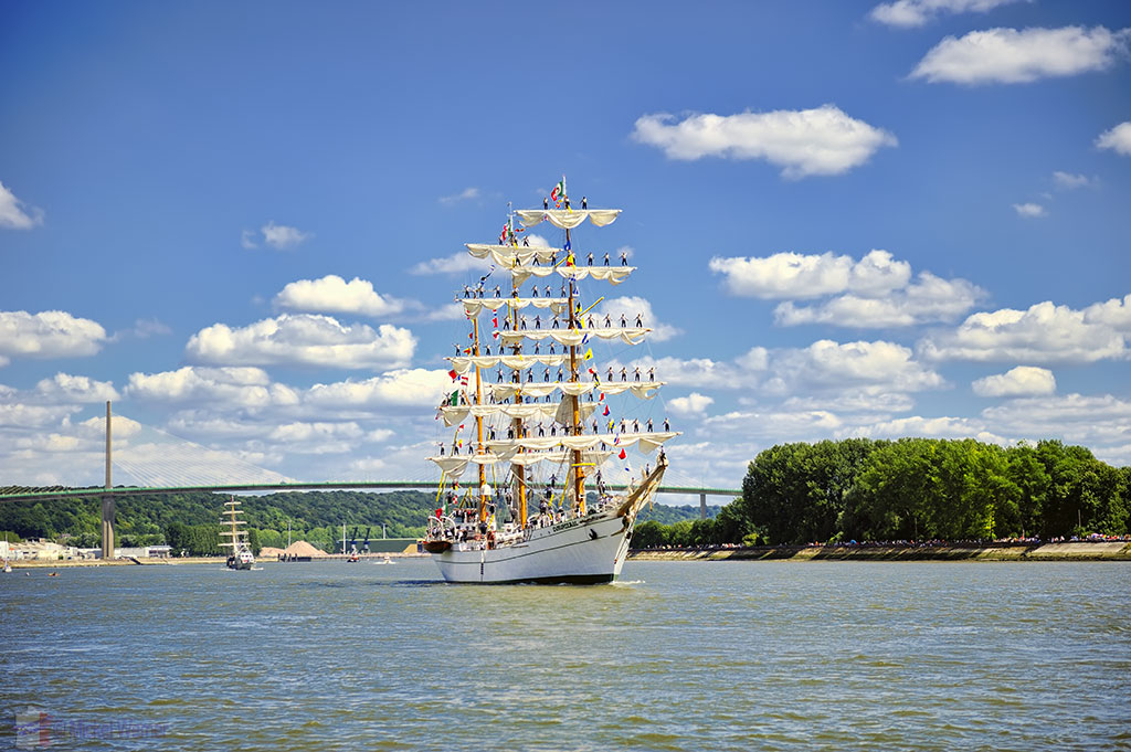 Armada Tall Sailing Ships passing under the Pont de Bretonne at Caudebec-en-Caux