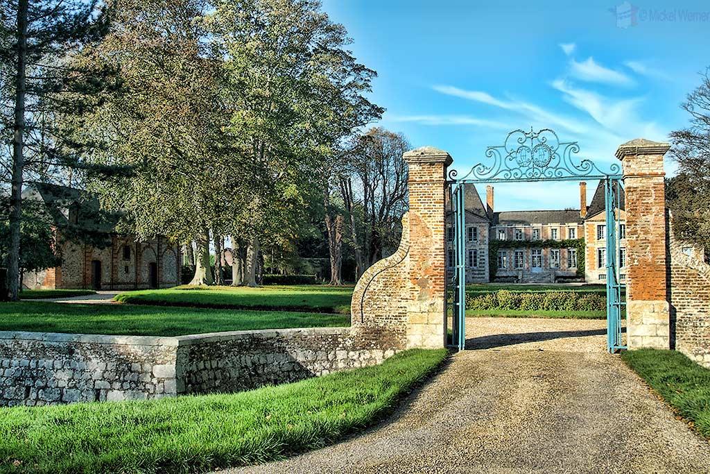 Gate of the castle at Saint Aubin-sur-Mer alongside the Normandy coastline.