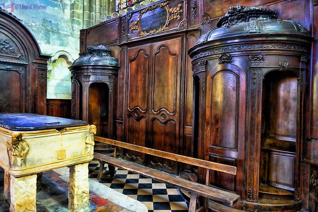 Old fashion confessional booths in the cathedral of Amiens