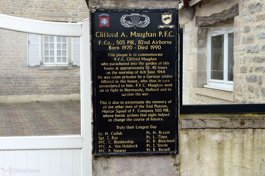 Sign about private Clifford Maughan and what happened to him when he landed in Sainte-Mere-Eglise