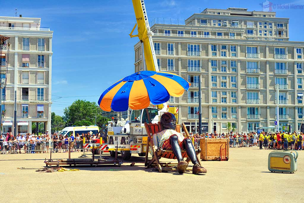 Time for a nap for the giant boy at the beach of Le Havre