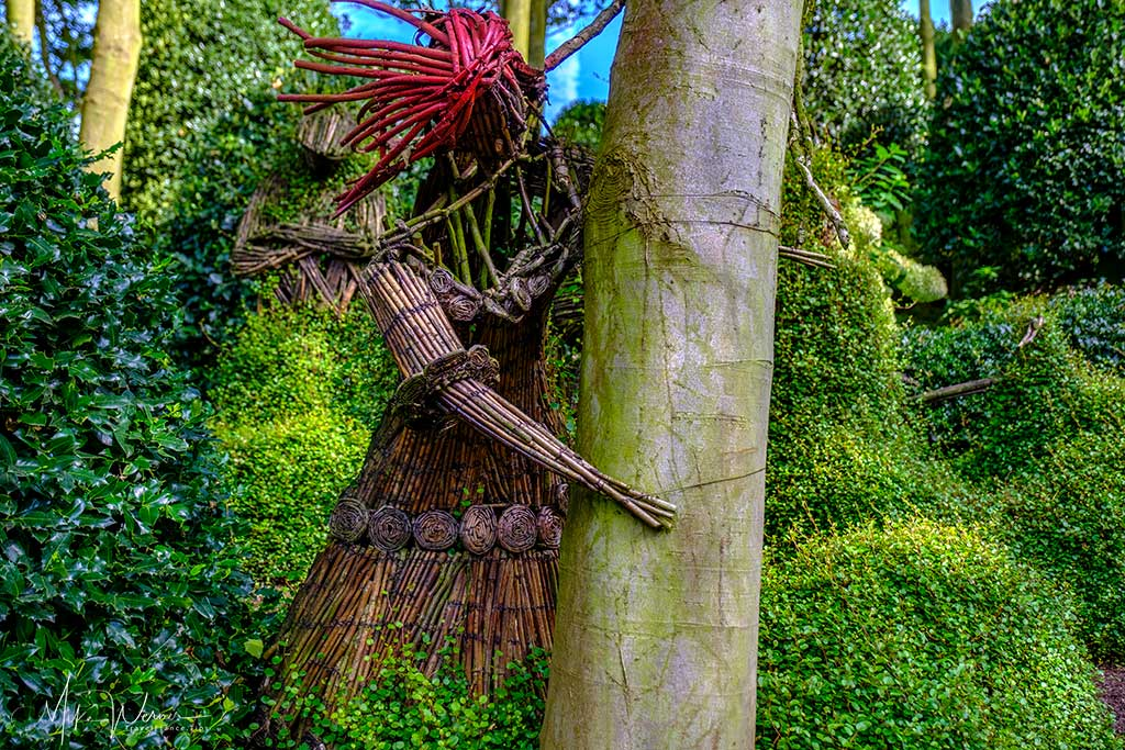 Straw character fixed to a tree in the Gardens of Etretat