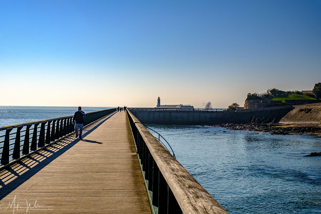 Long pier bringing you to one of the Les-Sables-d'Olonne ligthouses