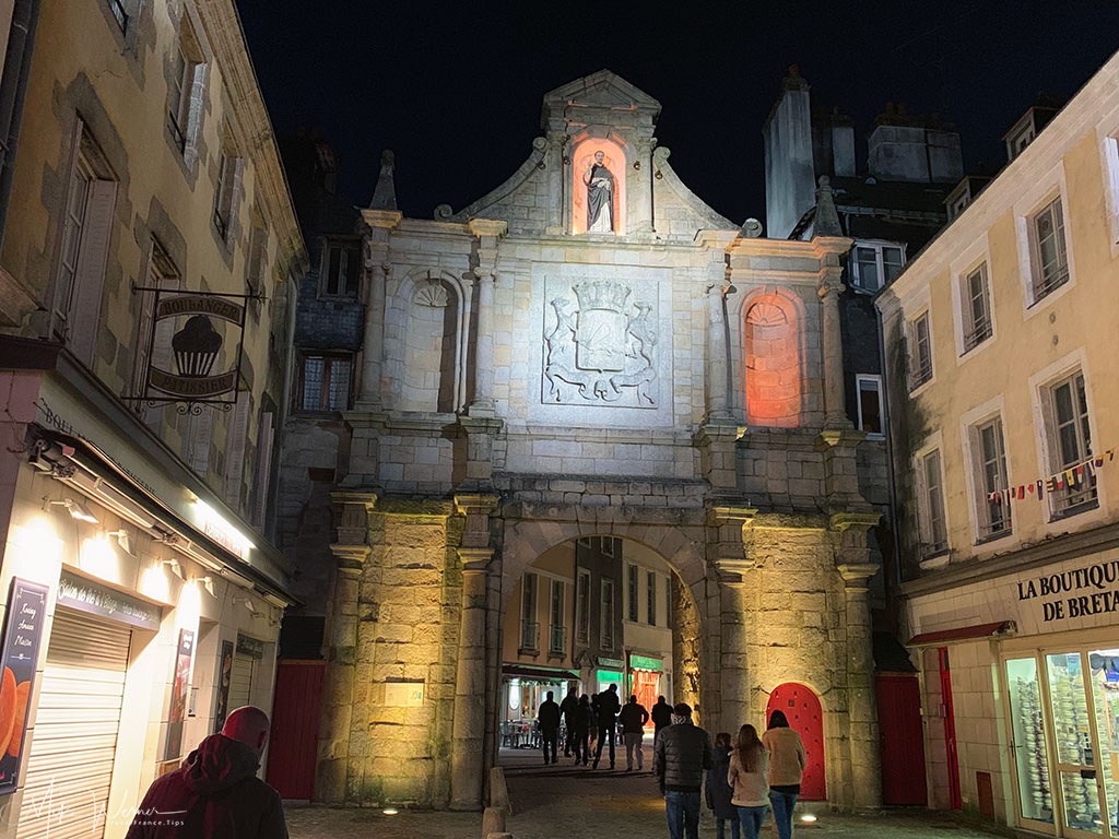 Harbour side view of the Saint-Vincent Gate at night alongside the ramparts of Vannes, the main gate into the harbour