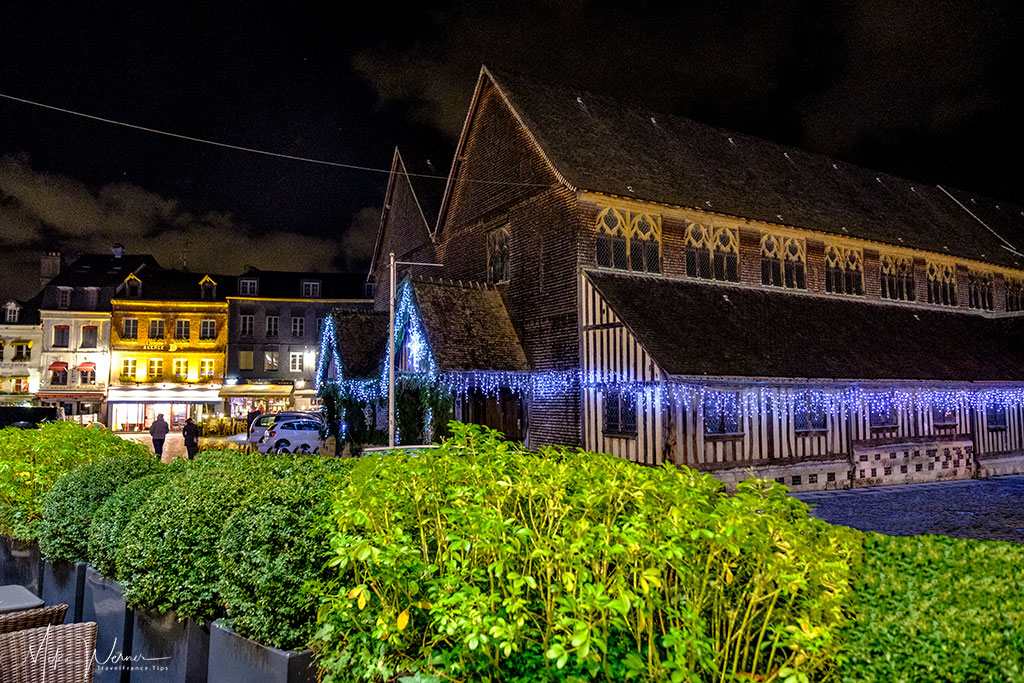 The mostly wooden nave of the Saint-Catherine church in Honfleur, Normandy at night