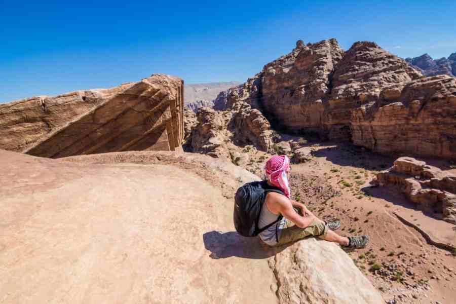 Sitting on top of the Monastery in the city of Petra, Jordan
