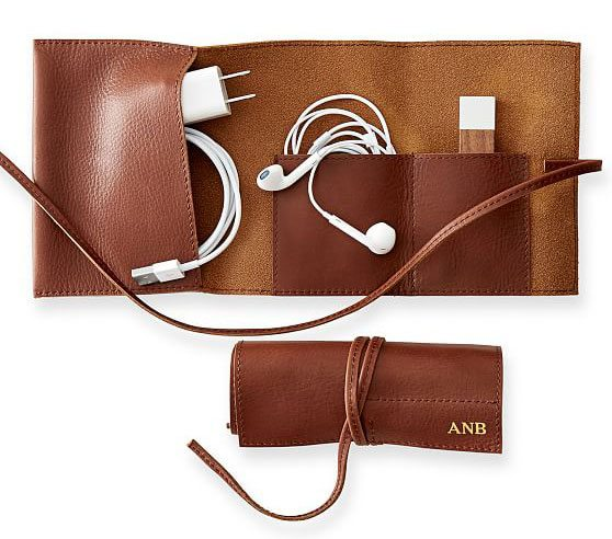 The Mark and Graham Leather Charger Roll Up is a fantastic gift for any woman who travels