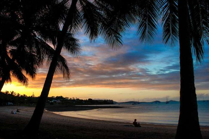 Sunset on Airlie Beach, Australia. Not a bad place to work and travel in Australia, right?