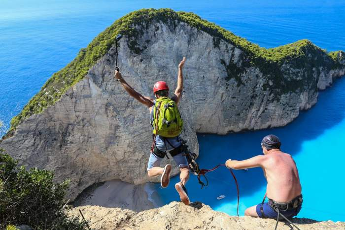 Rope jumping from the top of Navagio Beach