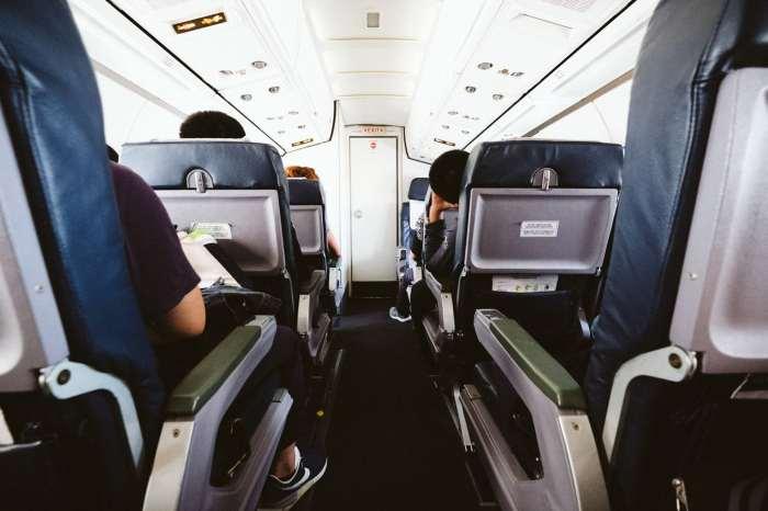 View down a plane's aisle.